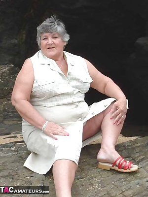 A rocky time for Libby dodging the beach-bumsBut well worth it to let the sun caress her beautiful breasts as she embrac