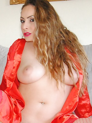Sophia now gets out her little red vibrator and slides it deep into her tight pussy.
