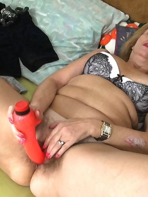 Blonde mature pushing dildo hard in her hairy pussy to get a hard orgasm