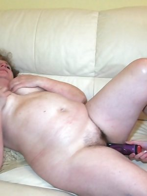 Old mature sucking cock while pushing toy in young pussy