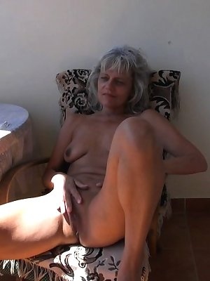 Gorgeous mature women getting horny and masturbating on the balcony