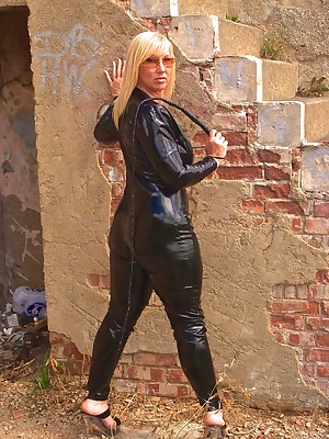 Black PVC cat suit, prowling around in the wilds. Who wants to be dominated Melody x