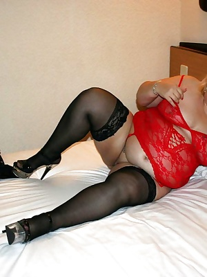 Hi GuysHere you find me in a large double bed when away in Holland. I had brought some new stripper heels with sparkles