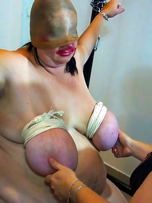 Fat mature woman getting bondage on her big tits