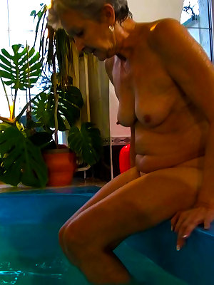 Old grandma getting horny in swimming pool
