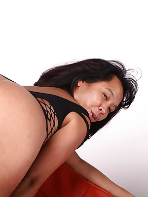 Asian girl, Melissa in this sexy black short dress... Wihout anything under she decided to show her hairy asian pussy...