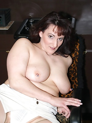 Enter your stylist half nude. She takes you to the shampoo bowl and leans over you with milky white breasts. What do you