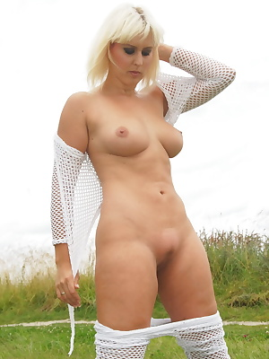 Brittany, in white fishnet trousers and top is flashing outdoors. She doesn't mind being watched full nude outdoors.