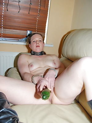 Horny housewife Shanon likes being a submissive slut wearing handcuffs.Shanon starts fucking a big cucumber on her couch