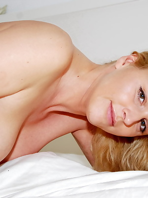 Sharon is laying on her bed dressed only in a purple bra and panties.Sharon is stripping all off and showing her nude bo