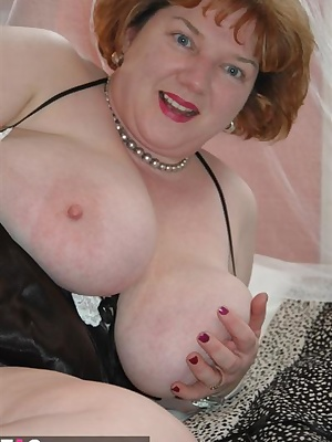 Some more photos to go with the Black Lingerie Strip story on my forum.  I just love to play with my breasts when Im all