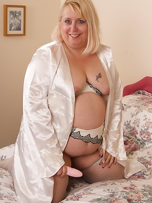 Hello Guys, Here you will see me all in creamA sexy satin jacket with matching lingerie, which I gradually strip off eac