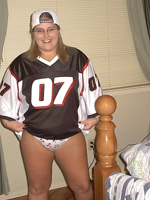 On a creative bent in February of 2003, hubby suggested that I put on a pair of girly panties, a fake softball jersey, a