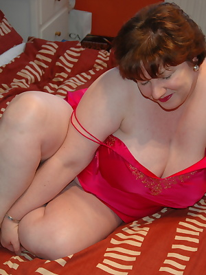 See me wearing my new pink silk camisole for you in these new photos. Good views of my BBW fat white belly and great big