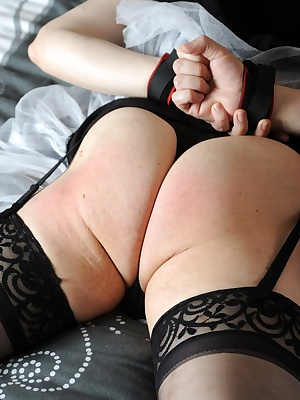 Carys binds Seraphim's hands and puts a spreader bar between her slave's ankles.After some time in a hog tie, thinking a