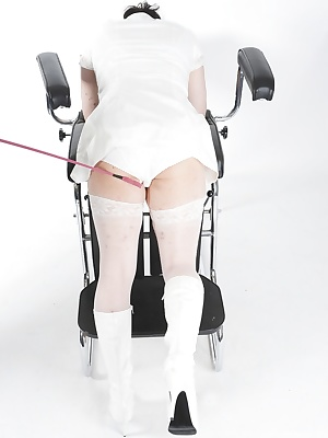 Carys ties nurse Seraphim to a chair before slipping her hand under his pvc dress. Seraphim is obviously enjoying the at