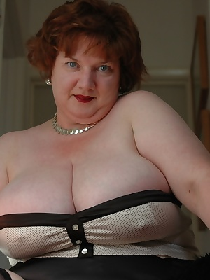 More corsets and stockings this week, I just love to wear them A nice satin cream polka dot corset this time, with some