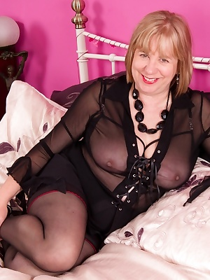 Hi Guys, in this set Im wearing a short Black Skirt with my see through blouse and a quarter cup bra underneath, so not