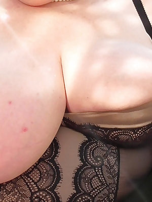 Senior granny playing with her huge boobs and masturbating using toys