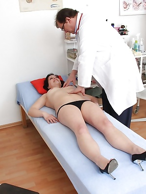 Older broad Lydie strips naked for Gyno dcotor to examine her