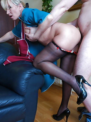 Mature maid in shiny pantyhose