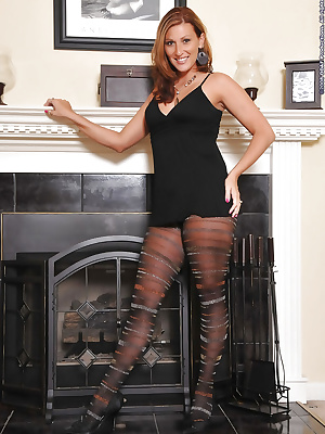 Sexual lady in patterned pantyhose posing