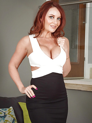 Mature pantyhouse Janet Mason in high heels flaunting her big tits