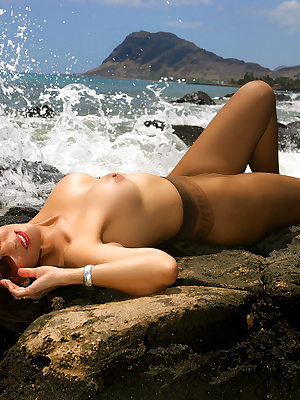 Mature babe in pantyhose and sun glasses goes topless on the beach