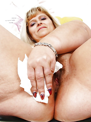 Overweight mature woman with saggy breasts toying hairy pussy with speculum