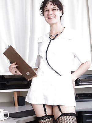 Mature nurse Sunshine stripping down to mesh stockings to display beaver