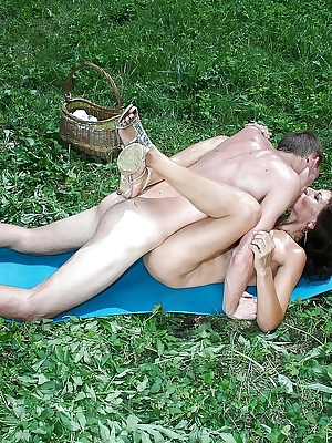 Mature babe licking ass and fucking in her shaved cunt outdoor