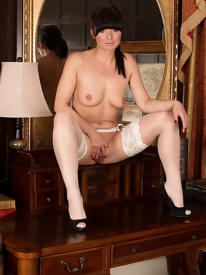 Mature MILF Roxanne Cox flashing pink vagina in white stockings