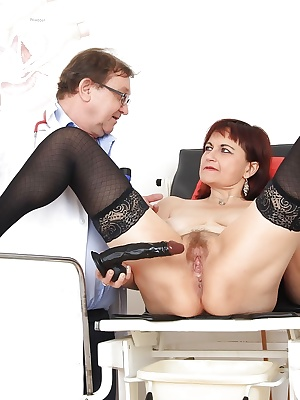 Mature woman in stockings has her hairy vagina checked out by kinky doctor