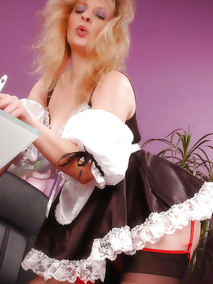 Mature maid does housework