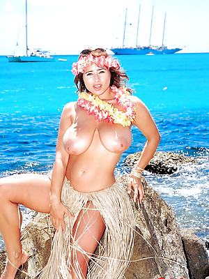 Older French chick Chloe Vevrier flaunting large all natural tits on beach