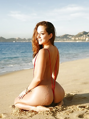 Beautiful babe Francesca Le shows these titties and ass on the beach