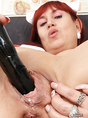 Fatty Mature redhead nurse Darja masturbates during the break