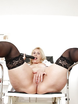 Naughty mature lady stuffing her twat with gyno tools and sex toys