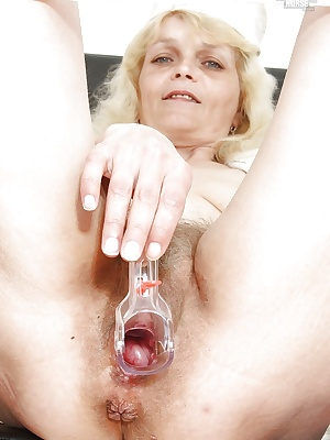 Mature lassie in nurse uniform exposing her unshaven twat