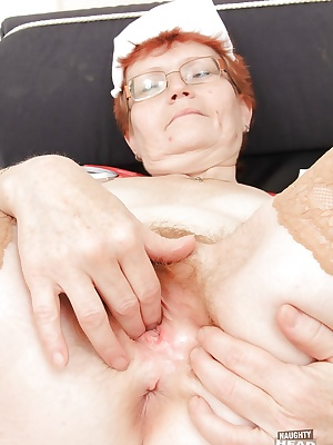 Mature nurse in glasses fingering her bushy twat and tasting her juices