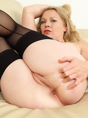 Hot British MILF Abigail Toyne loves to play with her wet pussy