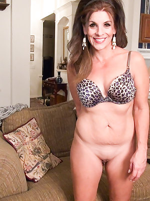 Older mature lady is stripping slowly and masturbating with sextoys