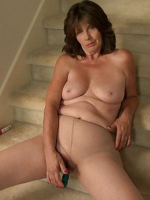 Granny masturbating alone on the staircase