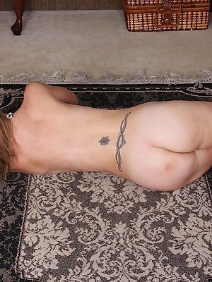Mature dame Heidi Van Moore revealing small tits before displaying hairy pussy