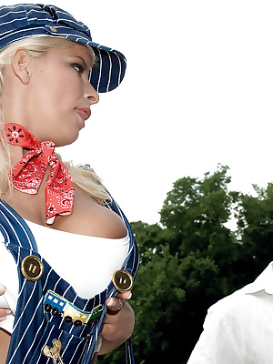 Busty MILF blonde fucked in automobile club