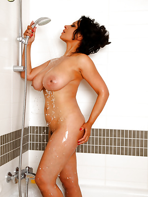 Busty MILF taking a shower