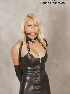Blonde cougar in leather dress