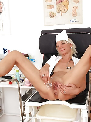 Sassy mature gyno nurse taking off her panties and playing with her tools