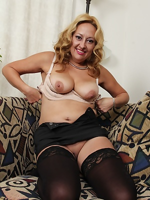 Undressing scene featuring horny mature slut Roxy Jennings in stockings
