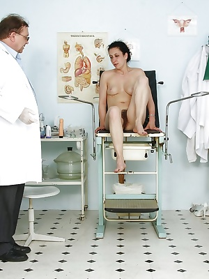 Mature woman with red hairy pussy comes for a gyno examination